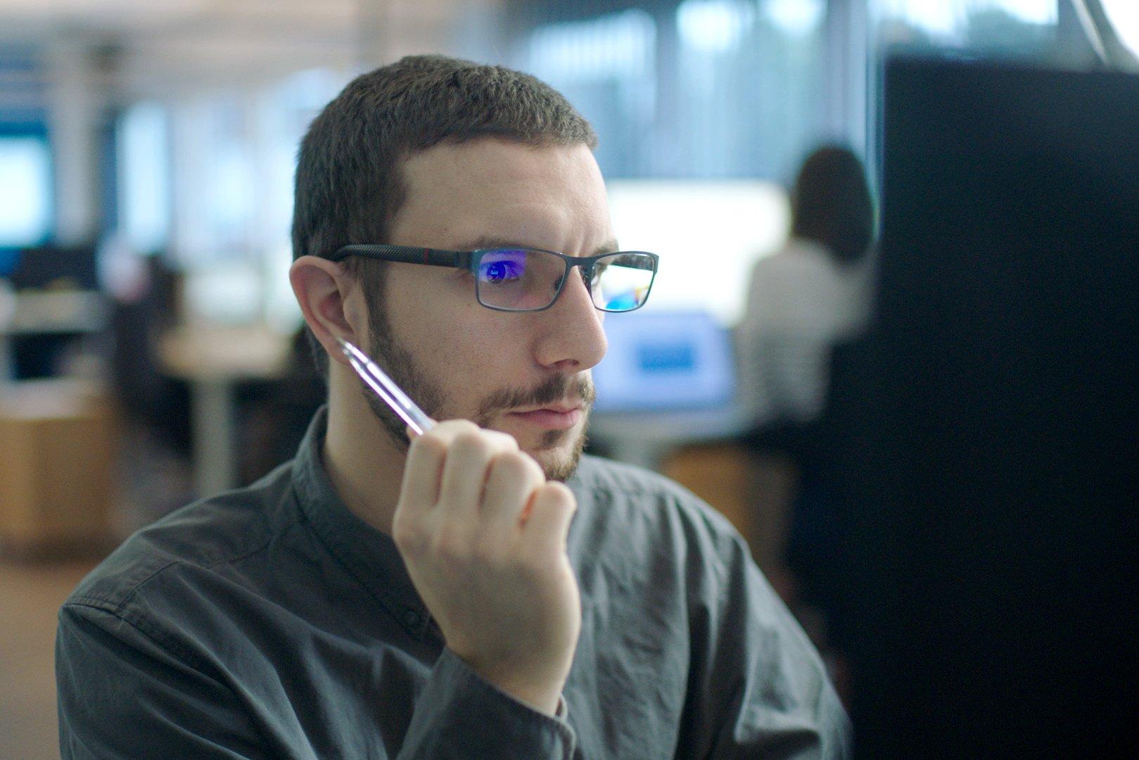 Administrator looking at his computer