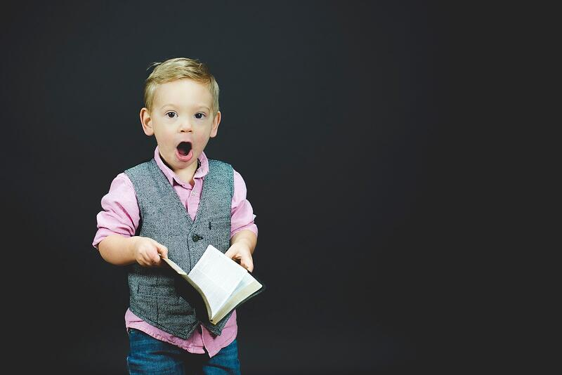 An excited child with a book