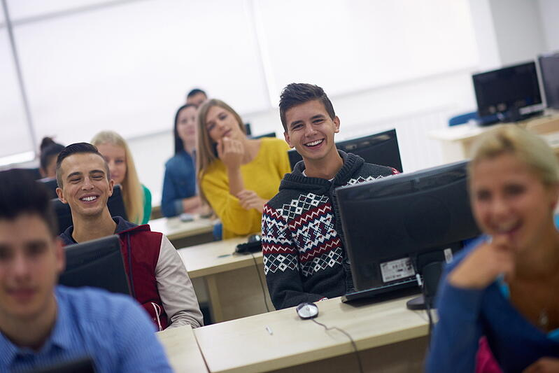 Students in a computer lab classroom